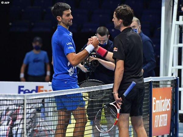 Novak Djokovic [kiri] masih harus menunggu untuk bisa memenangkan gelar ATP Finals keenam
