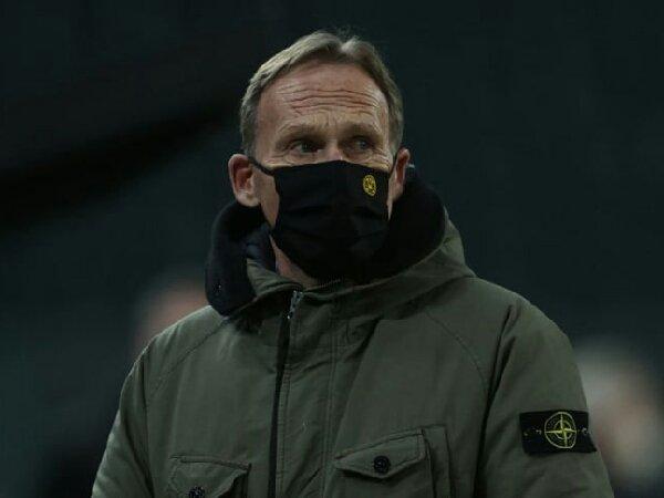 Hans-Joachim Watzke mengaku siap bertahan di Borussia Dortmund sampai krisis finansial mereka berakhir