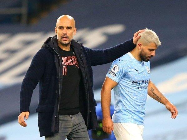 Pep Guardiola dan Sergio Aguero / via Getty Images