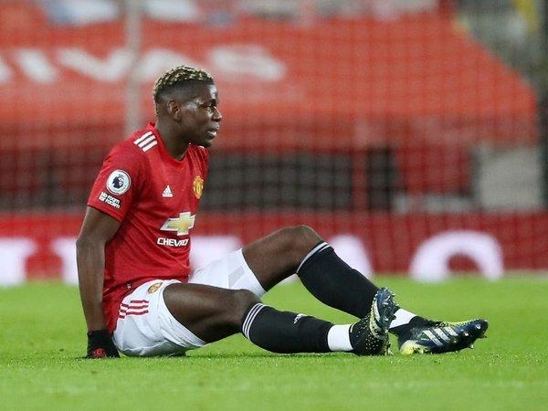 Paul Pogba mendapat sejumlah masukan dari Luis Nani jika ingin terus berkarier bersama Manchester United / via Getty Images