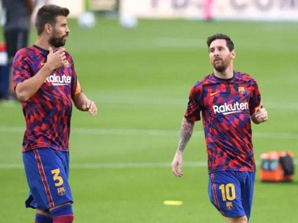 Gerard Pique berlatih bersama Lionel Messi. (Images: Getty)