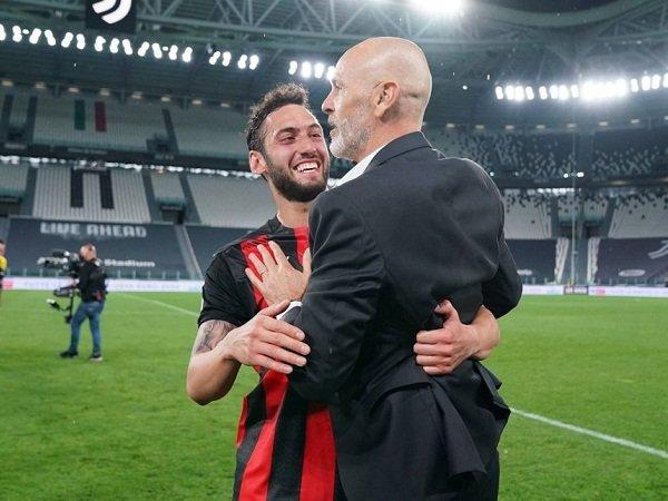 Hakan Calhanoglu dan Stefano Pioli