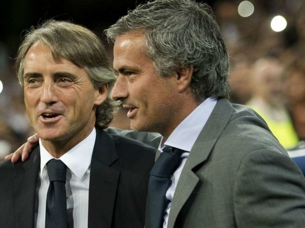 Jose Mourinho dan Roberto Mancini / via Getty Images